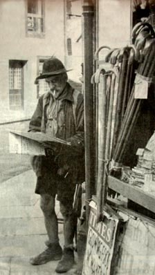 millican dalton on street corner looking at papers