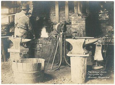 vintage blacksmith shop forging anvils fire