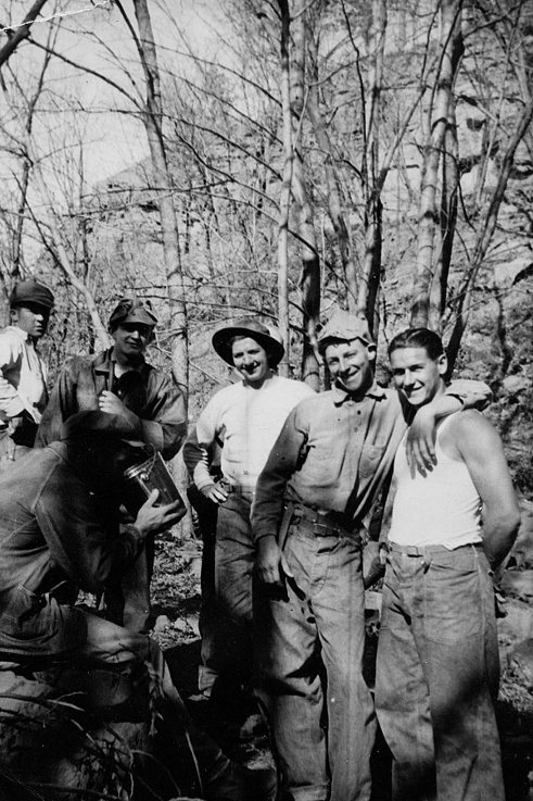 Civilian Conservation Corps men bonding woods
