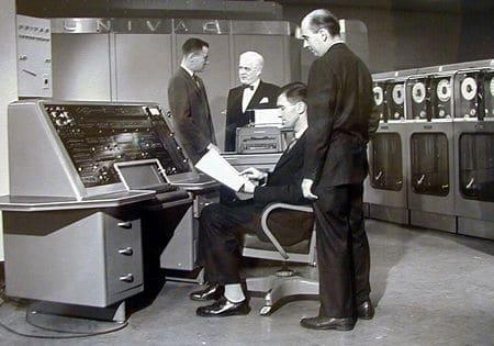 vintage 1950s computers men in room programming
