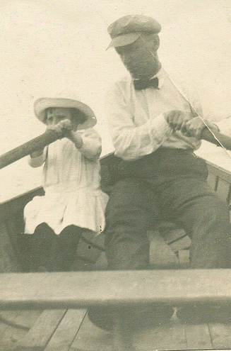 vintage father daughter rowing boat together