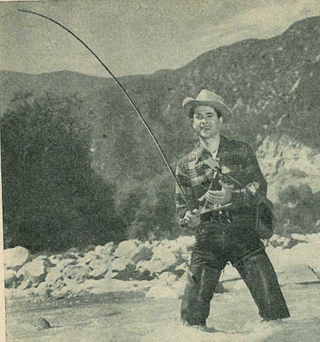 vintage man fishing wading in river mountains