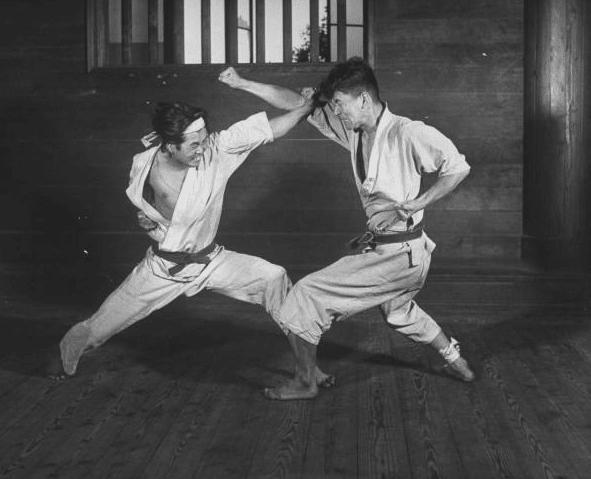 Vintage men doing practice of karate.