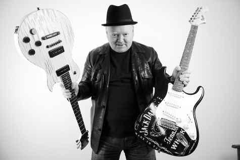 edward mitchell freelance writer with guitars