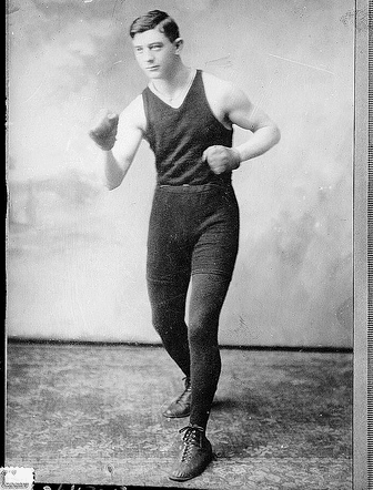 Vintage man standing in boxing pose.