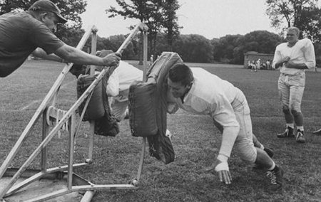 Vintage football player practicing in grounds.
