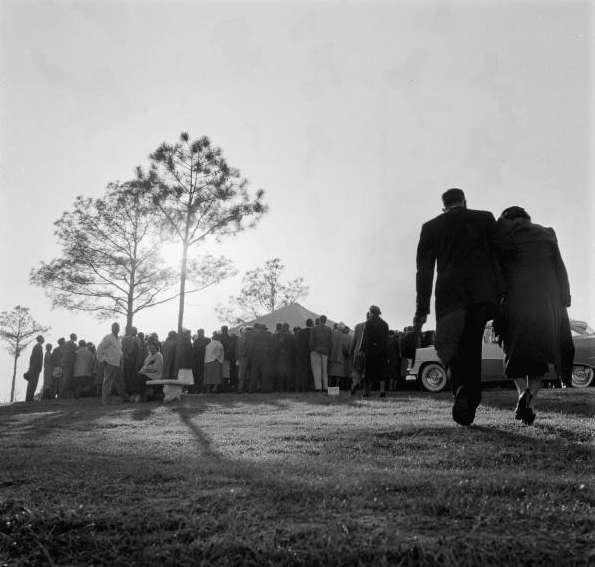 vintage funeral couple 1950s walking to grave