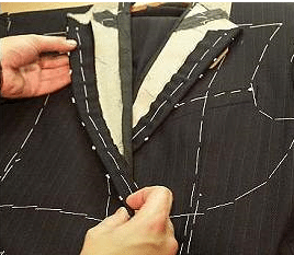 man working on fused suit stitching and lines