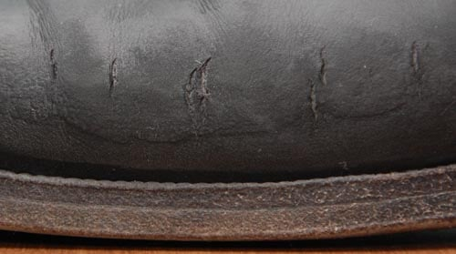 water damaged leather shoes close up photo