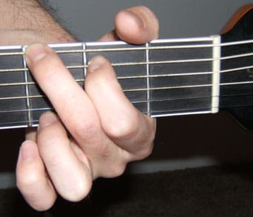 g chord photo close up of guitar neck