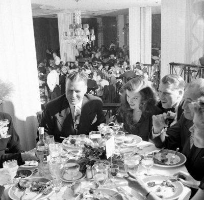 Vintage people enjoying dinner in restaurant.