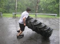 strongman odd object strength training lifting tires