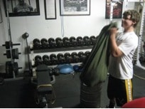 strongman odd object strength training sandbag lifting