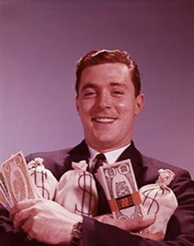 vintage man 1960s 1970s holding cash bags