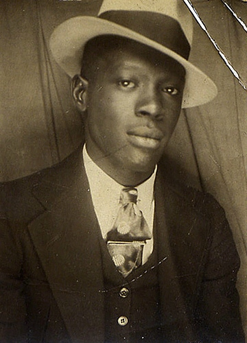 Vintage black American man wearing hat and suit.