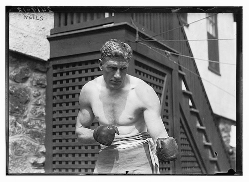 vintage boxer shirtless with gloves boxing posing