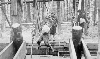 Vintage men on a ropes course.