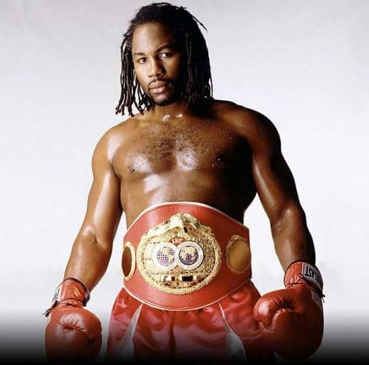 Lennox Lewis boxer boxing portrait wearing champion belt.