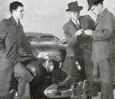 Vintage men negotiating for car.
