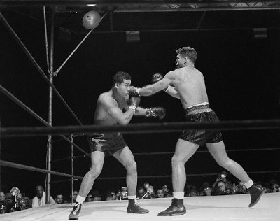 Vintage boxing match of Joe Louis in the ring.