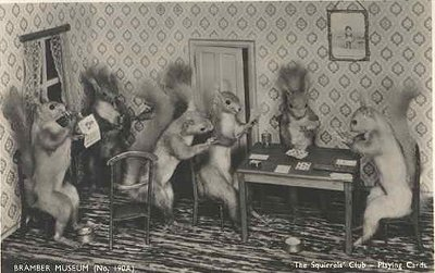 Vintage squirrels playing poker game in doll house.