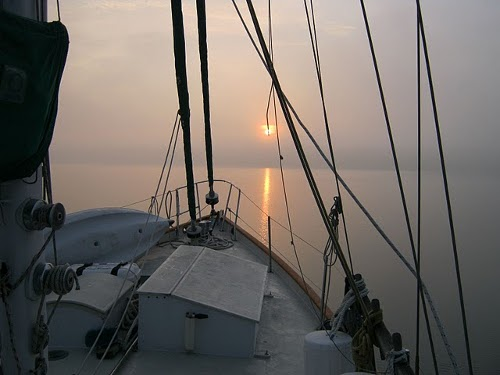 ocean and sun from bow of sailboat