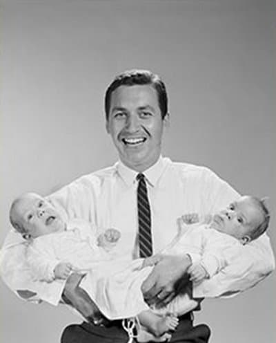 vintage father holding newborns twins shirt tie