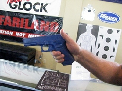 how to safely grip gun pistol