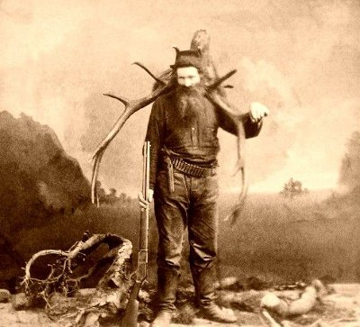 northwest vintage mountain man 1800s carrying antlers