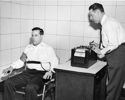 vintage man taking lie detector test