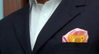pacifier in suit jacket pocket square fatherhood style
