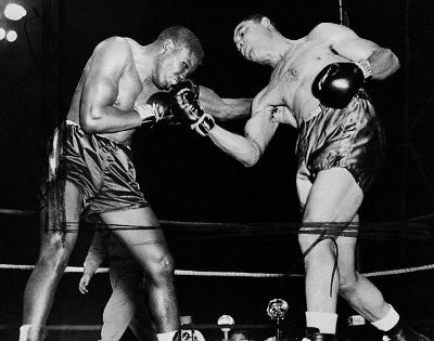 vintage boxing match upper cut in the ring
