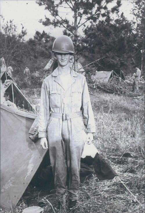 Robert Rader standing in military dress with helmet.