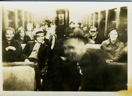 Vintage blurry subway train passengers portrait.