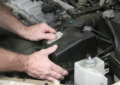 changing air filter box under car hood