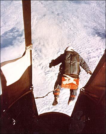 Joseph Kittinger parachuting above the Earth's surface.