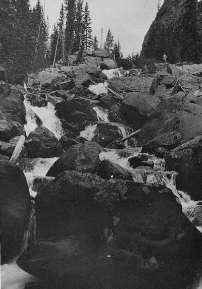 cascading mountain waterfall rocks black white