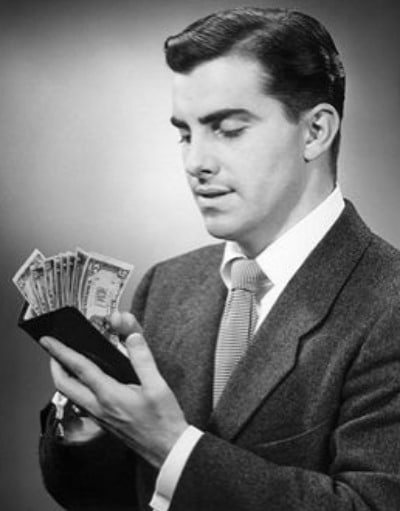 vintage man holding money cash wallet