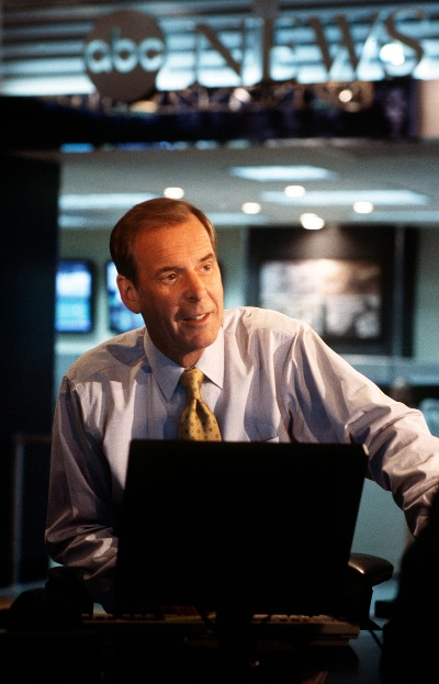 peter jennings abc news anchor at desk computer