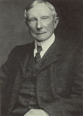 john rockefeller portrait waist up stern look
