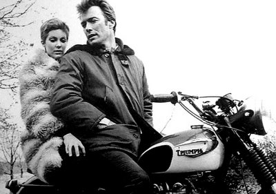 clint eastwood on motorcycle with wife fur coat