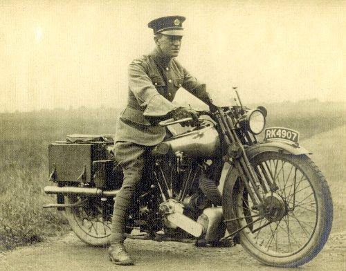 TE lawrence of arabia in military uniform on motorcycle