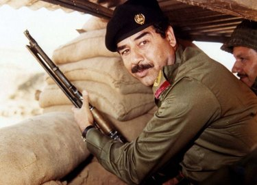 saddam hussein military uniform hat gun mustache