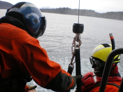 Adam Sustachek coast guard on a rescue mission.