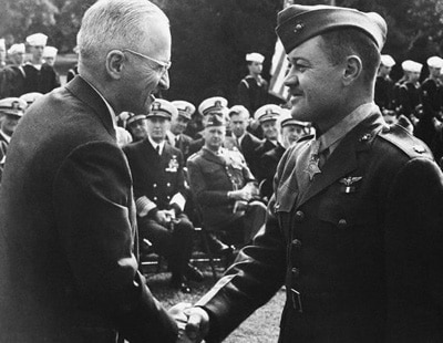 Pappy Boyington military uniform shaking hands