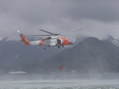 Coast guard on a rescue mission with helicopter.