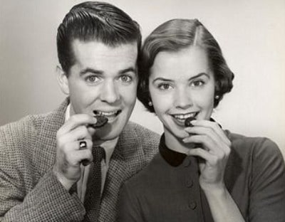 vintage couple eating cookies smiling portrait