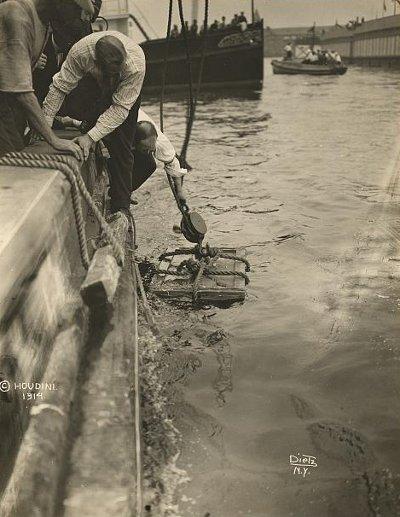 Harry Houdini lowered into New York Harbor, July 7, 1912.