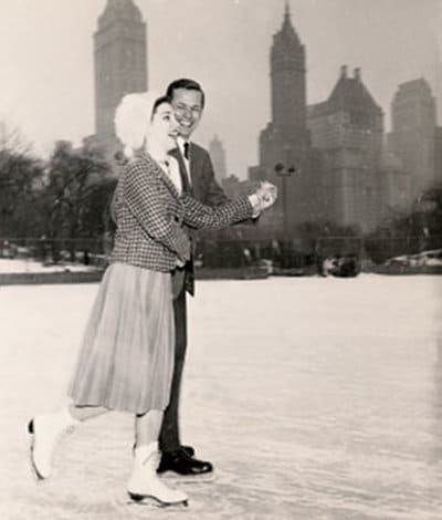 vintage couple ice skating in city