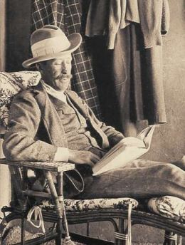 Lord Carnarvon explorer sitting in chair reading